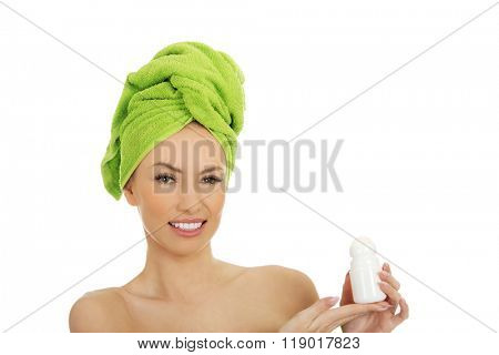 Young woman holding deodorant.