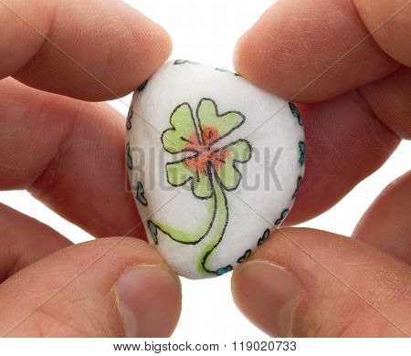 Stone With Drawing Of A Clover Four And Small Hearts