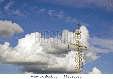 Majestic Cloudscape With Electrical Pylon