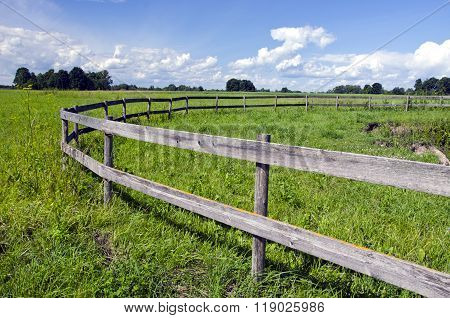 Pasture With A Wooden Fence