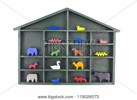 Shelf With A Roof Filled With Various Wooden Toy Figurines