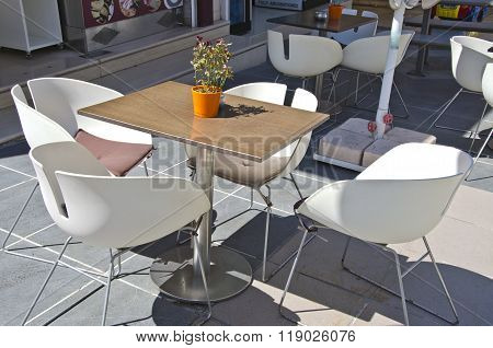 Table With Chairs In Outdoors Cafe