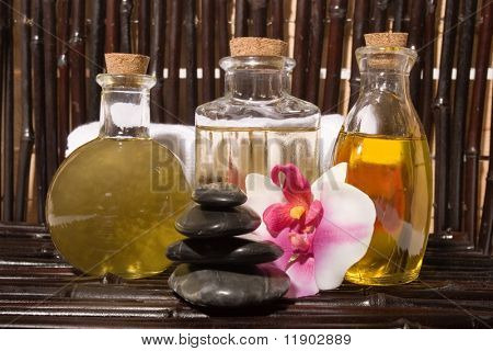Essential body massage oils in bottles for bodycare