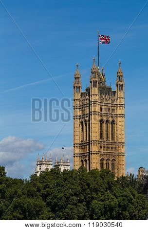 The Victoria Tower in London during the summer with the Union Jack Flag flying at the top of it