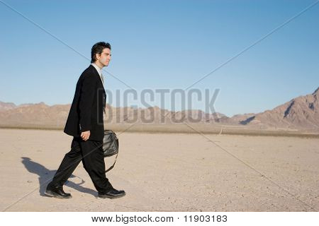 Businessman carrying his laptop case