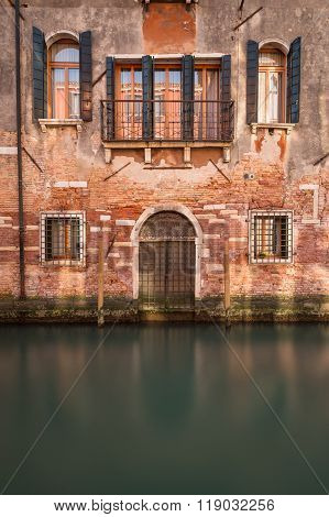 A view of old buildings along the Venetian Canals in the Cannaregio District of Venice.