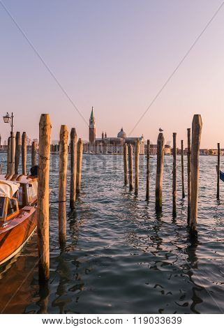The Church of San Giorgio Maggiore from the main Venice waterfront showing wooden posts in the foreground