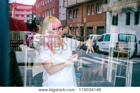 Woman hairdresser cutting woman hair in beauty salon