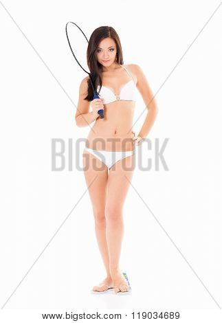 Young beautiful girl in a white bikini with tennis-racket, isolated on white background