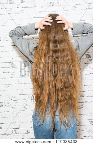 Young Woman With Very Long Wavy Brown And Blonde Hair