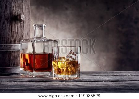 Square decanter and a glass of whiskey with ice