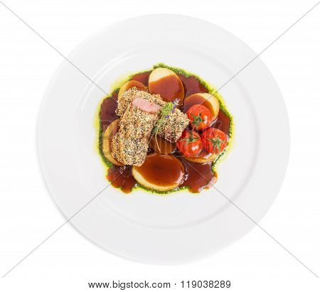Breaded pork fillet with tomatoes confit.