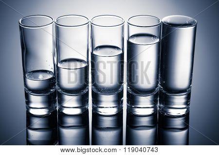 row of glasses for vodka
