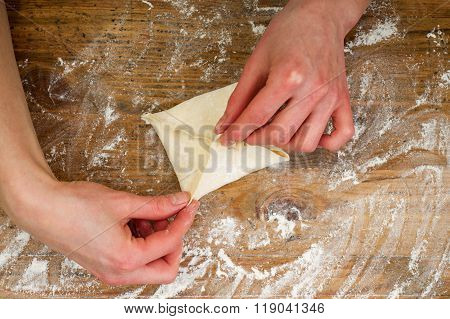 Woman's Hands Are Making A Cookie