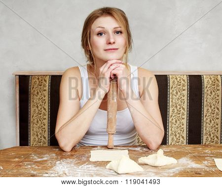 Woman Is Sitting On A Kitchen Making Cookies