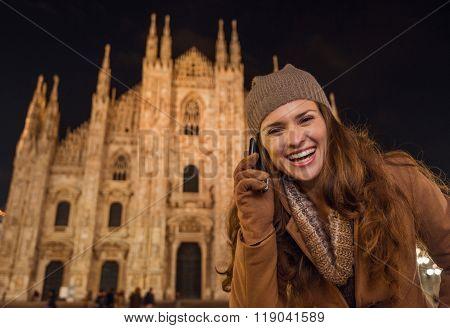 Smiling Woman Talking Cell Phone Near Duomo In Evening, Milan