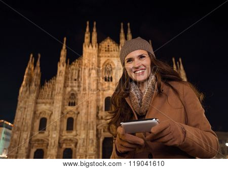 Happy Woman Writing Sms In Front Of Duomo In Evening, Milan