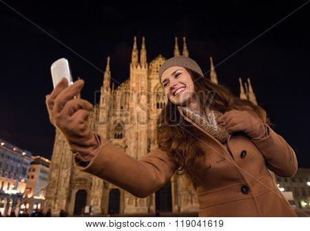 Smiling Woman Taking Selfie In Front Of Duomo In Evening, Milan