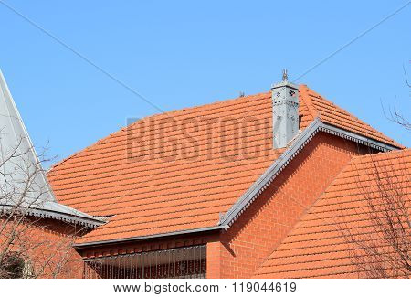 The House With A Roof Of Tiles