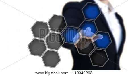 Man Pointing To A Glows Blue Hexagon Button.