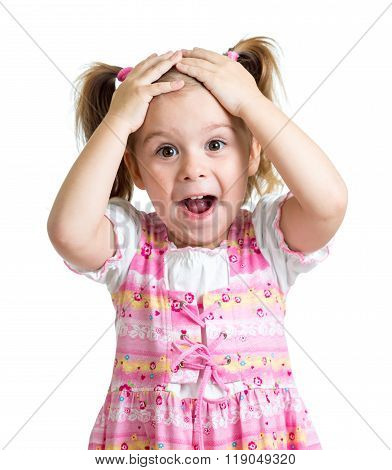 Amazed or surprised child girl hands holding head isolated