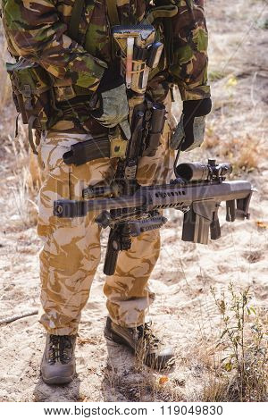 Sniper Rifle In  Hands Of Armed Soldier