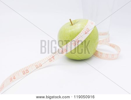 A Green Apple With A Measuring Tape Wrapped Around It For The Concept Of Bmi