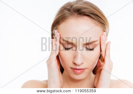 Closeup portrait of a young woman with headache isolated on a white background