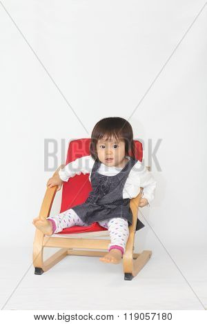 Japanese baby girl sitting on the chair (1 year old)