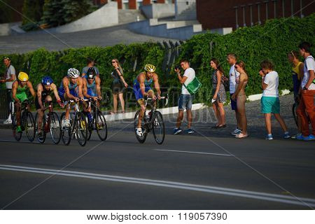 DNEPROPETROVSK, UKRAINE - MAY 24, 2014: Athletes race on the cycling stage of ETU Sprint Triathlon European cup. It's the first time Triathlon European Cup take place in Ukraine
