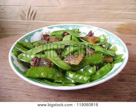 Fine dining snow peas stir fried meat