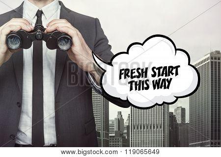 Fresh start this way text on speech bubble with businessman holding binoculars