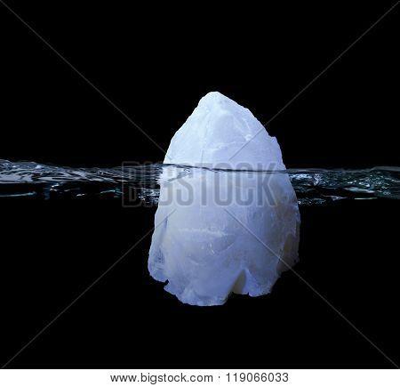 Frozen Iceberg Floating In Water