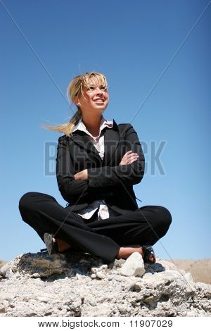 Young businesswoman outdoor against blue sky