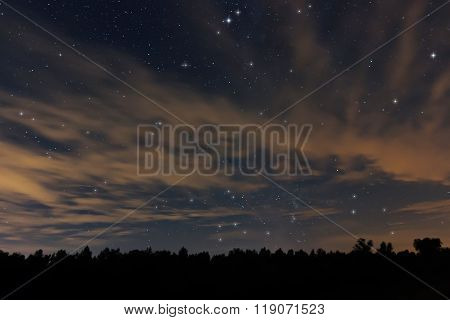 Beautiful night sky, with clouds and constellations, Aquarius, Aguila, Scutum, Ophiuchus, Serpens, S