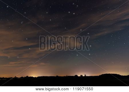 Beautiful night sky, with clouds and constellations, Hercules, Draco, Ursa Major, Ursa Minor, Big Di