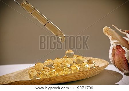 Glass Dropper On Capsules Of Garlic Oil