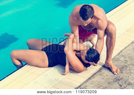 Lifeguard Taking Victim Out Of The Pool