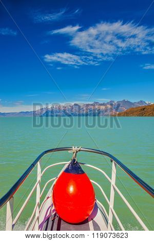 Unique lake Viedma in Argentine Patagonia.  The lake is surrounded by mountains. Big boat for tourists