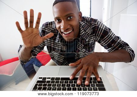 Young African Guy Video Chatting On Laptop At Home