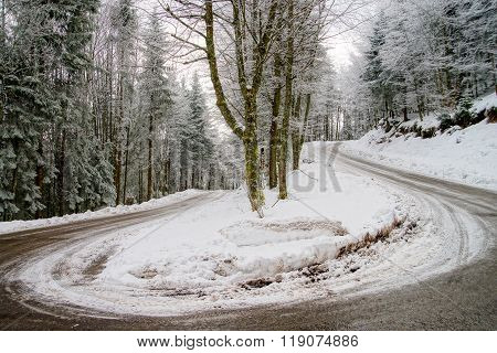 Greasy Winter Spiral Road In Beautiful Forest