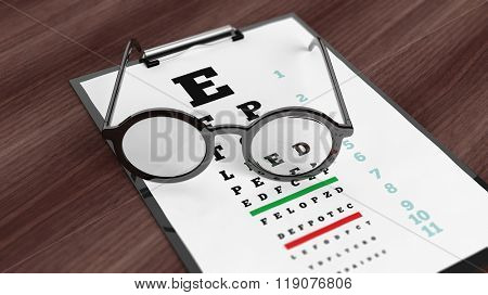 Eyeglasses on tablet with eyesight test on screen, set on wooden surface.