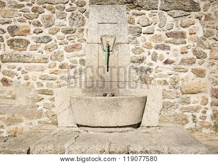 ancient stone made water fountain
