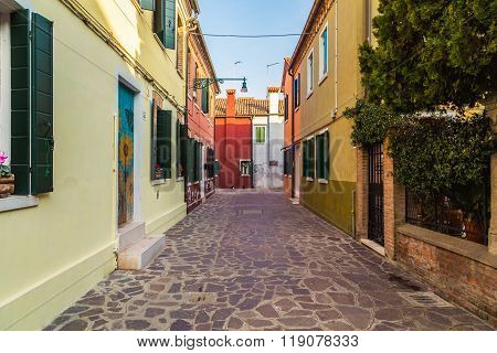 BURANO, ITALY - 14TH MARCH 2015: A view down streets in Burano during the day.