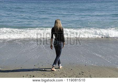 Girl Walking On The Shore