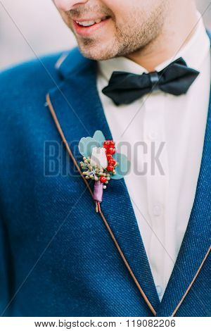 Vintage wedding boutonniere on the groom's suit close up