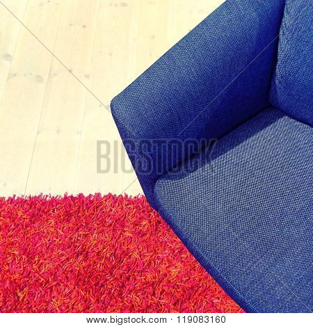 Blue Textile Armchair On Red Carpet