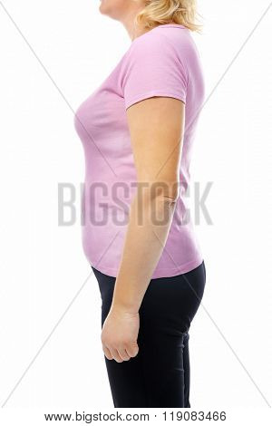 Chubby woman's body in pink tee-shirt and black pants isolated on white