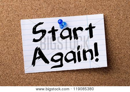 Start Again!  - Teared Note Paper Pinned On Bulletin Board