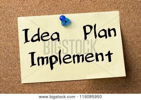 Idea - Plan - Implement - Adhesive Label Pinned On Bulletin Board
